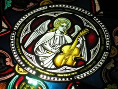 Detail of an Angel Playing the Cello in the Rose Window of the Children's Chapel of Loreto College - Sturt Street, Ballarat by raaen99, via ...