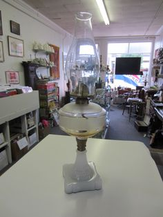 "We are back with lots of new treasures. This week our ""Pick"" is a fabulous Antique Oil Lamp with a hard to find ""Clambroth"" glass base. This lamp probably dates back to around 1860 to 1870."