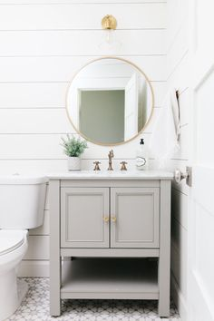 bathroom design with shiplap, gray cabinet and brass accents. Bathroom Vanity Designs, Bathroom Trends, Bathroom Interior Design, Home Interior, Grey Bathroom Vanity, Bathroom Mirror Lights, Downstairs Bathroom, Small Bathroom, Relaxing Bathroom