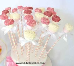Pink and white marshmallow pops dipped in white chocolate and coated with 100's and 1000's
