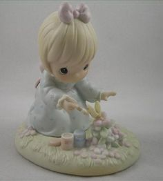 "Precious Moments ""God Bless You for Touching My Life"" Figurine Precious Moments,http://www.amazon.com/dp/B0010Y1F40/ref=cm_sw_r_pi_dp_oBdfsb0ZAZ28J147"