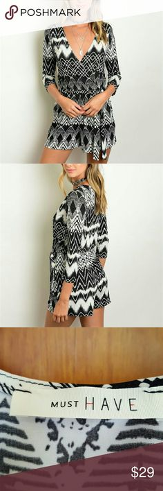 Black & white romper.    *****Small only***** 3/4 sleeve ,wrap front ,tie at waist, zig zag print romper. Polyester spandex blend.  Measurements taken just under arms of garmet laid flat.                S- 16 inches   L- 18 inches.  The wrap style is very roomy. I am a  Sz 12  dress and the large fits great! These are straight from manufacturer with no store tags. betjanz Pants Jumpsuits & Rompers