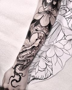 snake and flowers tattoo sleeve by @brunosantostattoo