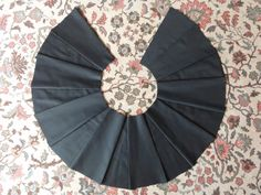 Making a flared, pleated skirt using panels.