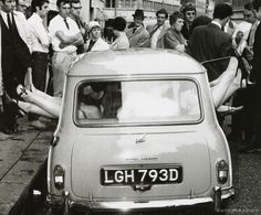 An attempt to break to world record for the greatest amount of people in a Morris MINI  Minor, 1966