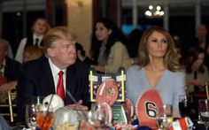 President Donald Trump and first lady Melania Trump watch the Super Bowl at a party at Trump International Golf Club in West Palm Beach, Florida