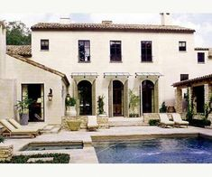 Pool, & French windows with glass / metal awnings above. Things That Inspire: Design Element: Metal and Canvas Awnings Spanish Style Homes, Spanish Revival, Spanish House, Spanish Colonial, Outdoor Spaces, Outdoor Living, Canvas Awnings, Mediterranean Home Decor, Tuscan Style