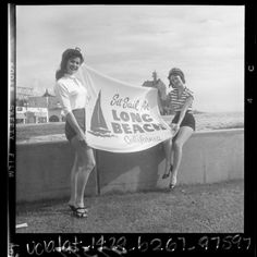 """Greeters, Mary Ann McHenry and Darlene Owen on boardwalk, holding up banner reading """"Set Sail for Long Beach California"""", 1956 Long Beach California, California History, California Dreamin', Los Angeles California, Vintage California, Vintage Beach Photos, City By The Sea, Los Angeles County, Set Sail"""