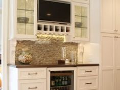 Amazing bar with gorgeous Arley brick mosaic backsplash. Leaded glass cabinetry doors. Built-in ice machine. Integrated bar refrigerator. General contracting by Martin Bros. Contracting, Inc.; kitchen by Hoosier House Furnishings, Inc.; interior design by