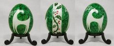 Christmas Egg with Deer and Holly on Duck Egg by Natakuaya