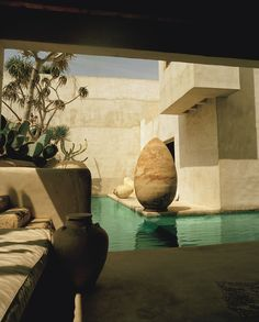 Seen from a banquette in the outside dining area. Dixon's pool flows throughout the house.