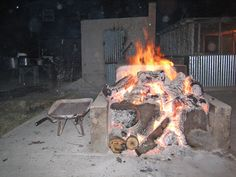 """Cooking fire at Bloys Campground during the annual August """"camp meeting"""", a Texas sized ranch family reunion with church services and hearty meals served by descendants of area pioneers. This fire is for roasting green chills. Green Chill, West Texas, Le Far West, Descendants, Painting Tips, Places To Eat, Ranch, Fire, Artists"""
