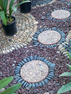I have some garden areas with pebbles outside them. A couple designs like this next summer would be adorable!