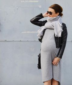 Stay cozy while you're expecting- leather jacket, sweater dress, and scarf