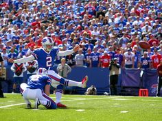Buffalo Bills kicker Dan Carpenter (2) kicks a field goal off the hold Colton Schmidt (6) during the first half of an NFL football game against the Arizona Cardinals on Sunday, Sept. 25, 2016, in Orchard Park, N.Y.
