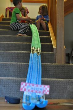 Cut noodles in half & duct tape together. Use marbles to race down the noodles. Use one noodle or more for a longer marble race. We took the family fun idea, and ran with it, we ended up connecting four water noodles. Going up two flights of stairs.... Amazing! Seriously, so easy, so cheap and so worth it!
