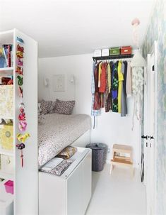 teen bedroom...I love the way the hanging rack is mounted near the ceiling.  This would be perfect for the girls' dresses.  They are so long sometimes, and little kid closet organization doesn't work for them.