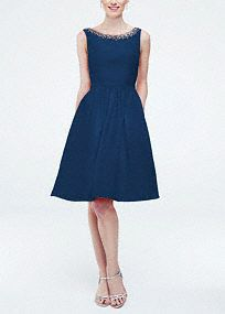 This unique and stylish bridesmaid dress is the epitome of modern chic!  Sleeveless faille dress with beaded neckline.  Eye-catching cut out back detail creates a stunning focal point.  Trendy pockets add convenience.  Fully lined. Back zip. Imported polyester. Dry clean. To protect your dress, try our Non Woven Garment Bag.