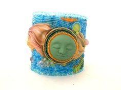 Hey, I found this really awesome Etsy listing at https://www.etsy.com/listing/213464469/face-shibori-bead-embroidered-cuff