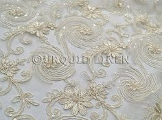 Jasmine Lace Fabric in Ivory - Bridal Lace Fabric w/ a Beautiful Sequins Embroidery Throughout - Perfect For Weddings and Special Events