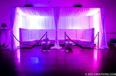 Birthday party. High back sectional lounge furniture with pipe and drape cabana, rope and stanchions and purple uplighting at The Gala Center in Baltimore Maryland