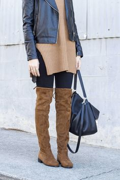 black and brown outfit: over the knee boots, side-slit sleeveless turtleneck, back jeans, black moto jacket