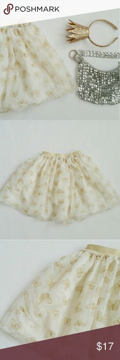 Gold Butterfly Skirt Perfect for your little princess!  Gold shimmery butterflies.  Elastic waistband.  Great condition.  No stain.  No odor. Bottoms Skirts