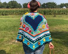 Crochet poncho adult blue ibizastyle gehaakte poncho folklore flowers heart blauw