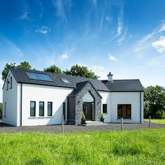 For Rodney and Emma McKay of Co Down, building a 'traditional' bungalow was out of the question. And the result is very different indeed to what you'd expect a one and half storey house to look lik… Modern Bungalow House Plans, House Plans Uk, Modern Bungalow Exterior, Small Bungalow, Bungalow House Design, Family House Plans, Modern Farmhouse Exterior, Bungalow Designs, Dormer House