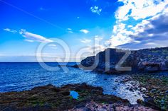 Qdiz Stock Images Stone Coast or Shore of Atlantic Ocean,  #Atlantic #background #beach #blue #Canary #cloud #cloudy #coast #coastline #day #horizon #island #landscape #nature #ocean #rock #rocky #sea #seascape #shore #sky #Spain #stone #summer #Tenerife #Travel #water #wave