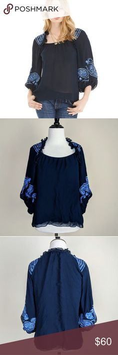 Nanette Lepore Kama Sutra Embroidered Silk Blouse For sale is a beautiful Nanette Lepore Kama Sutra blouse is navy blue. Features amazing embroidery, 100% silk fabric, and billowing sleeves. Has a minor snag. Nanette Lepore Tops Blouses