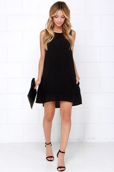 That cutie you've been eyeing won't be able to resist your enchantments in the Break the Spell Black Dress!  A sleeveless bodice (with darting) has a rounded neckline and figure-skimming fit, composed of lightweight poly. Small horizontal slits decorate the decolletage to give this charming dress a unique cutout look. Keyhole with button closure at back.