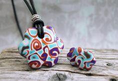 Swirly flowers. Jewelry set.  Polymer clay. Funky,  fun necklace earrings. colorful, boho, bohemian, leather clay, orange teal purple