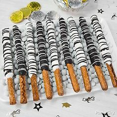 Drizzle on the class colors! Just melt Candy Melts® in both black & white, dip the pretzels, chill and drizzle with the opposite color! Easy, cute and super yummy!