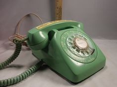 This is an awesome Mid century Sea Foam Green Automatic Electric Rotary Desk Phone . I have no way to test..We were told it works and we see no reason for it not to work but you are buying as is. Make