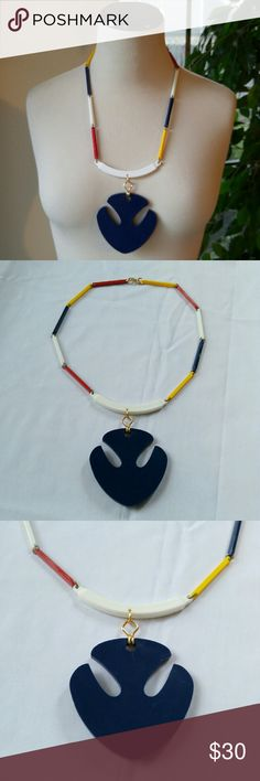 """VINTAGE OOAK Dove Pendant Plastic Link Necklace This necklace screams cool! Super mod 1960s 1979s style, the navy blue """"dove"""" pendant is huge, 3 1/4"""" in length. The entire necklace measures 25"""" with red hello and blue 2"""" long rectangular plastic links and a larger curved center piece. The connector holding the pendant and the clasp appear to be replacements. The rings between links are darker in color and thinner. This is a statement piece for sure. Vintage Jewelry Necklaces"""