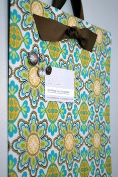 fabric covered magnetic board! perfect for the kids' artwork!