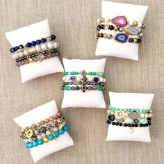 Small pillows for displaying bracelets at a craft show #JewelryDisplays
