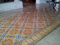A detailed pattern in rich colors creates a cement tile rug