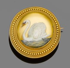 A reverse carved rock crystal intaglio brooch/pendant, circa 1870  The cabochon rock crystal carved and painted to the reverse with a swan within a ropetwist and beaded border, glazed compartment to the reverse, diameter 3.4cm