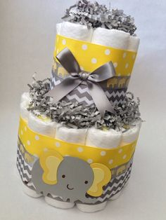 Yellow and Gray Diaper Cake, Baby Shower Centerpiece, Baby Shower Decoration, Yellow Grey Elephant Baby Shower, Neutral Diaper Cake by MrsHeckelDiaperCakes on Etsy https://www.etsy.com/listing/101779687/yellow-and-gray-diaper-cake-baby-shower