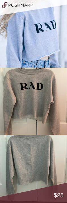 "Brandy Melville Cropped ""RAD"" Prada Sweatshirt Extremely soft and cozy sweatshirt. Barely used Brandy Melville Sweaters Crew & Scoop Necks"