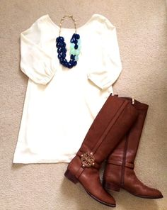 White blouse, bubble necklace and long boots
