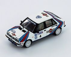 LANCIA DELTA HF 4WD #4 J.Kankkunen-J.Piironen Winner RAC Rally 1987 - Racing cars - Die-cast | Hobbyland Scale model car made ​​of metal / Die-cast / in 1:43 scale manufactured by IXO.  It is just a small version of a real car suitable for collectors. Handmade.  Composition: metal and plastic