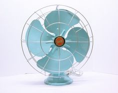 Such a lovely vintage fan. From FishboneDeco on Etsy.