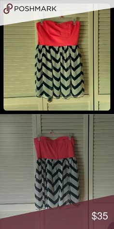 Strapless sweet heart neckline dress Beautiful sweet heart neckline dress, barely worn. Bottom is sheer black and white chevron with a black lining, top is colored samon. Tag says size 11 but fits like a medium to large. Trixxi Dresses Strapless