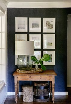 "Southern Newlywed: At Home with Cary and Ryan Ray - Southern Weddings Dark (blue) accent wall to display/showcase photos/art. perfect for entryway or an otherwise ""empty"" area Home Interior, Interior Design, Interior Office, Modern Interior, Dark Accent Walls, Navy Walls, Chevron Walls, Black Walls, Sweet Home"
