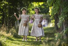 Each of the six flower girls threw garden-rose petals, which they carried in little wicker baskets. The baskets were inspired by an antique version we found on Etsy. The linen canvas ballet flats they wore were from Marie-Chantal.