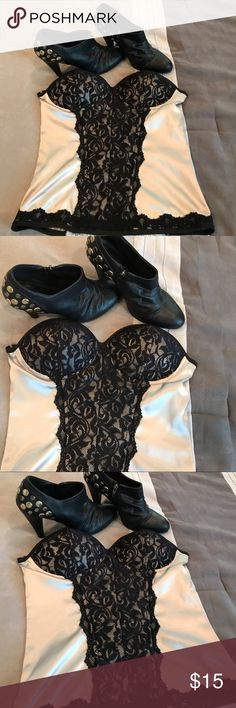 Beautiful corset New with tags Corset size medium in great conditions tags still attached!!  Busts are cupped slightly padded with beautiful lace detail!!  Boots are sold separately look for them in my closet Wet Seal Tops Camisoles