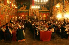 medieval banquet:  I'm mostly interested in the arrangement of the tables.  Three long rows with a gap and then the head table (from where the photo is taken).